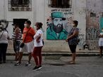 FILE PHOTO: People wait in line to enter a store that sells products in U.S. dollars in Havana, Cuba, July 20, 2020. REUTERS/Alexandre Meneghini/File Photo