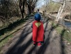 Life inside a red zone:A child dressed in a Superman outfit walks down a street in Casalpusterlengo, one of the towns on lockdown due to a coronavirus outbreak, in this picture taken by schoolteacher Marzio Toniolo in Casalpusterlengo, Italy, February 26, 2020. Picture taken February 26, 2020. Marzio Toniolo/via REUTERS THIS IMAGE HAS BEEN SUPPLIED BY A THIRD PARTY. MANDATORY CREDIT