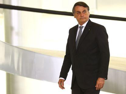 """Jair Bolsonaro participa de cerimônia de lançamento de programa de qualificação do atendimento de agentes comunitários de saúde, o """"Saúde com Agente"""", em dezembro de 2020."""