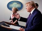 President Donald Trump speaks about the coronavirus in the James Brady Press Briefing Room of the White House, Thursday, April 2, 2020, in Washington, as Dr. Deborah Birx, White House coronavirus response coordinator, listens. (AP Photo/Alex Brandon)