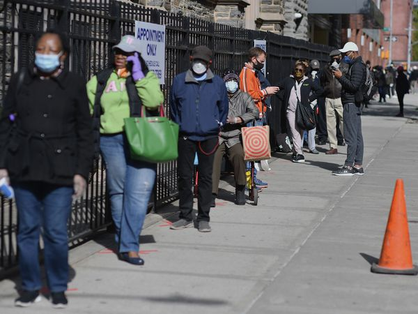 Residents wait in line to get tested for COVID-19 antibodies at Abyssinian Baptist Church in the Harlem neighborhood of New York City on May 14, 2020. - Churches in low income communities across New York are offering COVID-19 testing to residents in conjunction with Northwell Health and New York State. (Photo by Angela Weiss / AFP)