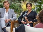 "This image provided by Harpo Productions shows Prince Harry, from left, and Meghan, The Duchess of Sussex, in conversation with Oprah Winfrey.  ""Oprah with Meghan and Harry: A CBS Primetime Special"" airs March 7.  (Joe Pugliese/Harpo Productions via AP)"