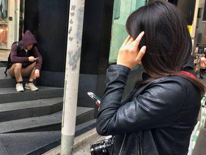 Jovens no bairro de Shibuya, Tóquio.