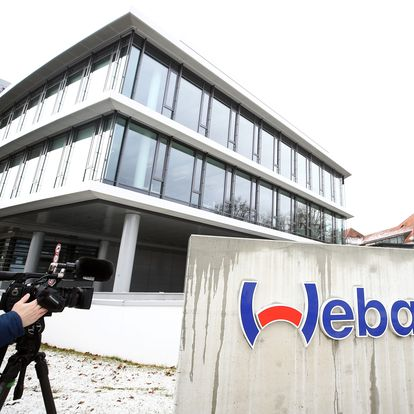 A cameraman films the headquarters of the German company Webasto, where four employees have tested positive for the coronavirus, in Stockdorf near Munich, Germany, January 29, 2020.    REUTERS/Michael Dalder