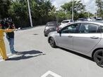A television crew interviews a driver in line at a drive-through COVID-19 testing site, Friday, March 20, 2020, at the Doris Ison Health Center in Miami. (AP Photo/Wilfredo Lee)