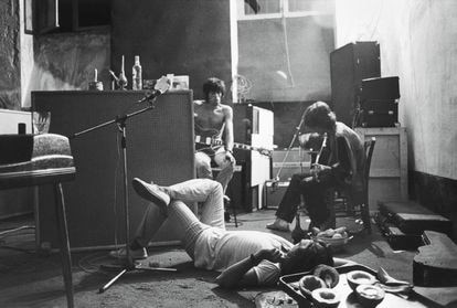 Jimmy Miller (on the ground), Keith Richards (left) and Mick Jagger (right) in the Villa Nellcote burrows, 1971.