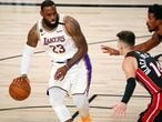 Oct 11, 2020; Lake Buena Vista, Florida, USA; Los Angeles Lakers forward LeBron James (23) dribbles while defended by Miami Heat guard Tyler Herro (14) during the first quarter in game six of the 2020 NBA Finals at AdventHealth Arena. Mandatory Credit: Kim Klement-USA TODAY Sports