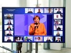 "German Chancellor Angela Merkel addresses participants as shown on a screen at the Chancellery during ""Citizen Dialogue"" (Buergerdialog) as part of ""The Chancellor in Conversation"" series in Berlin, Germany November 12, 2020. John Macdougall/Pool via REUTERS"