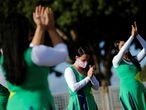 Faithful Evangelicals and supporters of Brazil's President Jair Bolsonaro pray in front the Alvorada Palace, amid coronavirus disease (COVID-19) outbreak, in Brasilia, Brazil, April 5, 2020. REUTERS/Adriano Machado