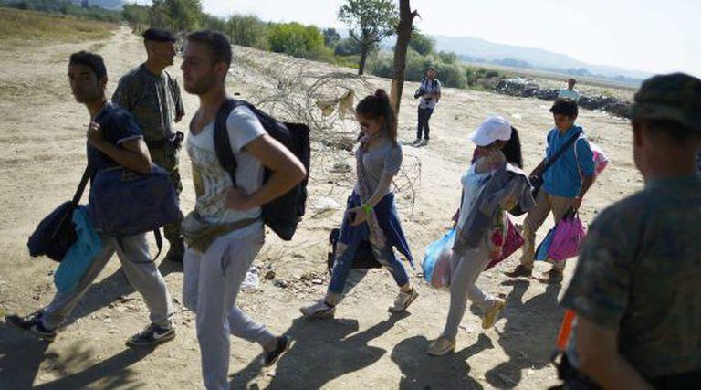 Imigrantes na fronteira entre Macedônia e Grécia em 28 de agosto.