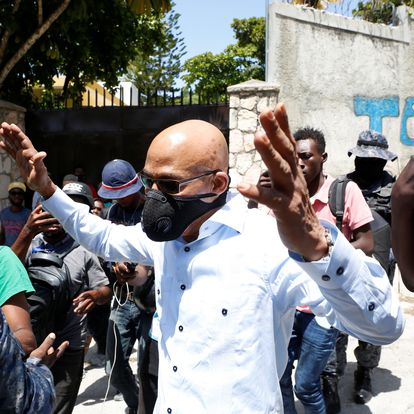 Secretary General of Haiti's presidency Lionel Valbrun gestures after leaving the residential area where Haiti's President Jovenel Moise was shot dead at his private home by gunmen with assault rifles, in Port-au-Prince, Haiti July 7, 2021. REUTERS/Estailove St-Val NO RESALES. NO ARCHIVES