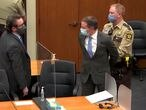 Former Minneapolis police officer Derek Chauvin is led away in handcuffs past his defense attorney Eric Nelson after a jury found him guilty of all charges in his trial for second-degree murder, third-degree murder and second-degree manslaughter in the death of George Floyd in Minneapolis, Minnesota, U.S. April 20, 2021 in a still image from video.  Pool via REUTERS