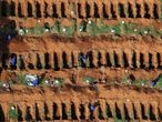 Gravediggers open new graves as the number of dead people rose after the coronavirus disease (COVID-19) outbreak, at Vila Formosa cemetery, Brazil's biggest cemetery, in Sao Paulo, Brazil, April 2, 2020. REUTERS/Amanda Perobelli