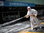 A member of the armed forces disinfects the entrance of a hospital during the coronavirus disease (COVID-19) outbreak in Brasilia, Brazil, March 31, 2020. REUTERS/Ueslei Marcelino