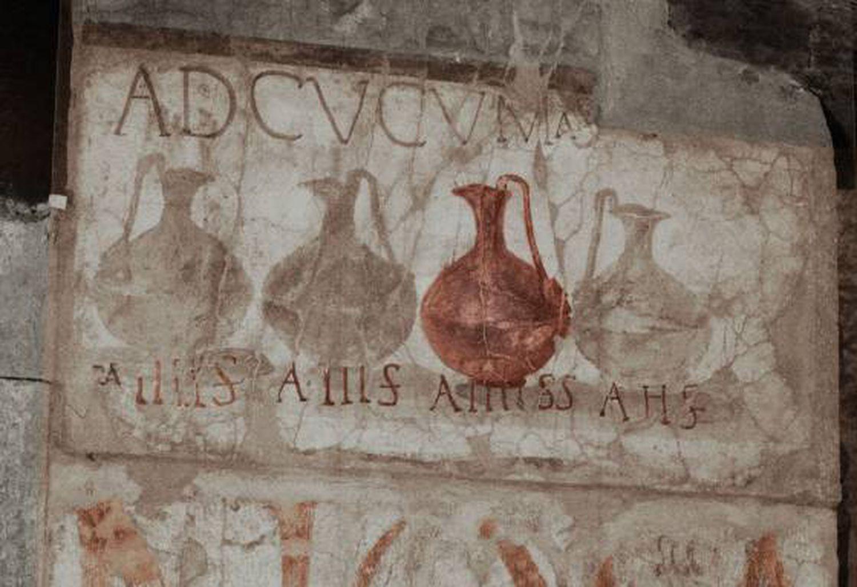Cartaz com publicidade de diferentes tipos de vinho, em Herculano.