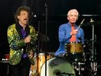 FILE - Rolling Stones drummer Charlie Watts, right, performs behind singer Mick Jagger during their concert at the Rose Bowl, Thursday, Aug. 22, 2019, in Pasadena, Calif. Watts died in London today at age 80. (AP Photo/Chris Pizzello, File)