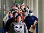 FILE PHOTO: Hundreds of people line up outside a Kentucky Career Center hoping to find assistance with their unemployment claim in Frankfort, Kentucky, U.S. June 18, 2020. REUTERS/Bryan Woolston/File Photo/File Photo