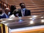 Mourners pause by the casket of George Floyd during a funeral service at the Fountain of Praise church, in Houston, Texas, U.S., June 9, 2020. David J. Phillip/Pool via REUTERS