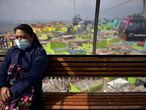 A woman wears a face mask as a preventive measure against the spread of the new coronavirus, COVID-19, at a cable car in Bogota, on March 16, 2020. - The Colombian government announced the indefinite suspension of face-to-face classes in public schools and universities as a preventive measure against the COVID-19 pandemic. (Photo by Raul ARBOLEDA / AFP)
