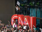 EDS NOTE: OBSCENITY - Demonstrators paint on the CNN logo during a protest, Friday, May 29, 2020, in Atlanta, in response to the death of George Floyd in police custody on Memorial Day in Minneapolis. The protest started peacefully earlier in the day before demonstrators clashed with police. (AP Photo/Mike Stewart)
