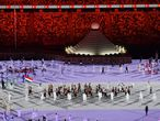 Tokyo (Japan), 23/07/2021.- Foil fencer Aida Mohamed and swimmer Laszlo Cseh carry the national flag as the team of Hungary parades during the opening ceremony of the Tokyo 2020 Olympic Games in the Olympic Stadium in Tokyo, Japan, 23 July 2021. (Hungría, Japón, Tokio) EFE/EPA/Zsolt Czegledi HUNGARY OUT