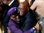 "FILE PHOTO: 91st Academy Awards - Oscars Show - Hollywood, Los Angeles, California, U.S., February 24, 2019. Film director Spike Lee (L) embraces presenter Samuel L. Jackson as he wins his first Oscar, the ""Best Adapted Screenplay"" award for ""BlacKkKlansman."" REUTERS/Mike Blake/File Photo"