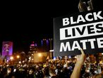 "FILE PHOTO: A demonstrator holds up a ""Black Lives Matter"" sign during a protest over the death of a Black man, Daniel Prude, after police put a spit hood over his head during an arrest on March 23, in Rochester, New York, U.S. September 6, 2020. REUTERS/Brendan McDermid/File Photo"