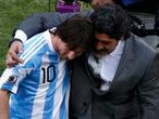 Argentina's coach Diego Maradona (R) and Lionel Messi hug after their 2010 World Cup Group B soccer match against South Korea at Soccer City stadium in Johannesburg June 17, 2010. REUTERS/David Gray (SOUTH AFRICA  - Tags: SPORT SOCCER WORLD CUP)