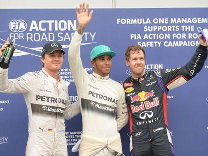 Rosberg, Hamilton e Vettel, depois da classificação.