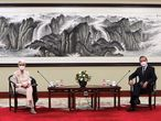 """In this photo provided by the U.S. Department of State, U.S. Deputy Secretary of State Wendy Sherman, left, and Chinese Foreign Minister Wang Yi sit together in Tianjin, China, Monday, July 26, 2021. China came out swinging at high-level face-to-face talks with the United States on Monday, blaming the U.S. for a """"stalemate"""" in bilateral relations and calling on America to change """"its highly misguided mindset and dangerous policy."""" (U.S. Department of State via AP)"""