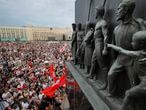 "FILE - In this Tuesday, Aug. 18, 2020 file photo Belarusian opposition supporters gather for a protest rally in front of the government building at Independent Square in Minsk, Belarus, with a Soviet era sculptures in the foreground. European Union leaders are putting on a show of support Wednesday Aug. 19, 2020 for people protesting in Belarus. Emergency talks will aim to highlight their concern about the contested presidential election and ratchet up pressure on officials linked to the security crackdown that followed. The EU believes that the results of the Aug. 9 polls, which handed President Alexander Lukashenko his sixth term with 80% of the vote, ""have been falsified,"" and the 27-nation bloc is preparing a list of Belarus officials who could be blacklisted from Europe over their roles. (AP Photo/Dmitri Lovetsky, File)"
