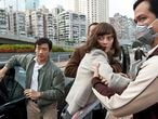 """In this image released by Warner Bros. Pictures, Chin Han, left, and Marion Cotillard are shown in a scene from the film """"Contagion."""" (AP Photo/Warner Bros. Pictures, Claudette Barius)"""