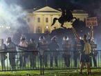Police in riot gear keep protesters at bay in Lafayette Park near the White House in Washington, U.S. May 31, 2020.  Picture taken May 31, 2020. REUTERS/Jonathan Ernst