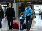 Families wear protective face masks as they walk with their luggage at Tarradellas Barcelona-El Prat Airport, after further cases of coronavirus were confirmed in Barcelona, Spain March 11, 2020. REUTERS/Nacho Doce