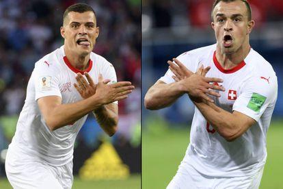 Xhaka (esquerda) e Shaqiri comemoram os gols contra a Sérvia com o gesto da águia, símbolo da bandeira albanesa.