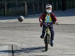 BEIJING, CHINA - MARCH 17: A young boy wearing a mask as part of precautionary measures against the spread of the COVID-19 in Beijing on March 17, 2020 in Beijing, China. Since the new coronavirus covid-19 first emerged in late December 2019, more than 182,992 cases have been recorded in 157 countries and territories, killing 7,177 people. (Photo by Fred Lee/Getty Images)