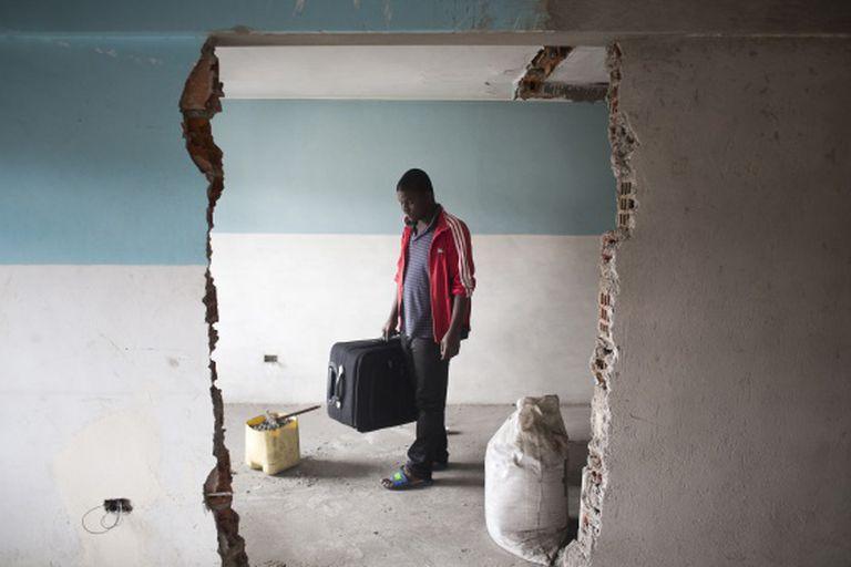 Haitianos no Equador, à espera de um visto brasileiro.