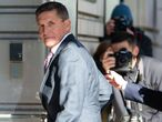 (FILES) In this file photo taken on December 18, 2018 former US National Security Advisor General Michael Flynn arrives for his sentencing hearing at US District Court in Washington, DC. - US President Donald Trump in a tweet announced on November 25, 2020, he has pardoned his former national security advisor Michael Flynn. Flynn pleaded guilty in 2017 to lying to the FBI over his Russian contacts. (Photo by SAUL LOEB / AFP)
