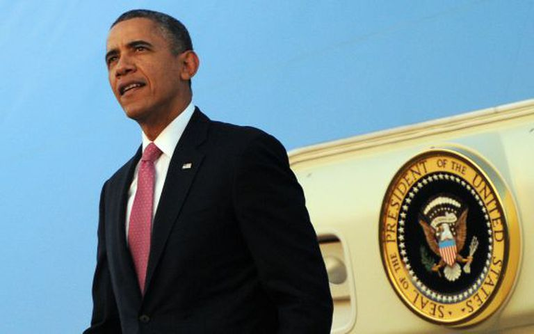 O presidente Obama a sua chegada a Seattle neste domingo.
