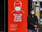 A man wearing a mask waits at a bus stop in London, following the outbreak of the coronavirus disease (COVID-19), London, Britain, June 5, 2020. REUTERS/Toby Melville