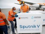 FILE PHOTO: FILE PHOTO: Workers take care of the shipment of Russia's Sputnik V vaccine against the coronavirus disease (COVID-19) at the airport, in Caracas, Venezuela March 29, 2021. REUTERS/Manaure Quintero/File Photo