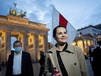 Belarusian opposition leader Svetlana Tikhanovskaya is welcomed by supporters, during a rally, by the Brandenburg Gate in Berlin, Monday, Oct. 5, 2020. Tikhanovskaya fled from Belarus following the disputed Aug. 9, presidential election, that forced her into exile. (Kay Nietfeld/dpa via AP)