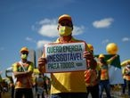 """A demonstrator holds a sign reading """"I want endless energy for all"""" during a protest in favor of the use of solar energy in front of the National Congress in Brasilia, Brazil June 8, 2021. REUTERS/Adriano Machado"""