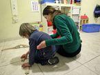 Centro para niños con autismo, sesión de apoyo visual, en Valencia.