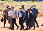 Brazilian President Jair Bolsonaro (3-L) visits the construction site of a field hospital for people infected with the new coronavirus in Aguas Lindas, Goias State, Brazil on April 11, 2020. - Authorities confirmed the first deaths in Rio de Janeiro's slums, where overcrowding and poor sanitation have raised fears of a catastrophe. (Photo by EVARISTO SA / AFP)