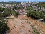 Rescue workers, residents, and volunteers search for victims after a mudslide caused by heavy rains in the coastal city of Guaruja, Brazil, Wednesday, March 4, 2020. Storms have pummeled Brazil's southeastern coast, causing deadly landslides and leaving people homeless. (AP Photo/Andre Penner)