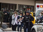 BOULDER, CO - MARCH 22: Healthcare workers walk out of a King Sooper's Grocery store after a gunman opened fire on March 22, 2021 in Boulder, Colorado. Dozens of police responded to the afternoon shooting in which at least one witness described three people who appeared to be wounded, according to published reports.   Chet Strange/Getty Images/AFP) == FOR NEWSPAPERS, INTERNET, TELCOS & TELEVISION USE ONLY ==